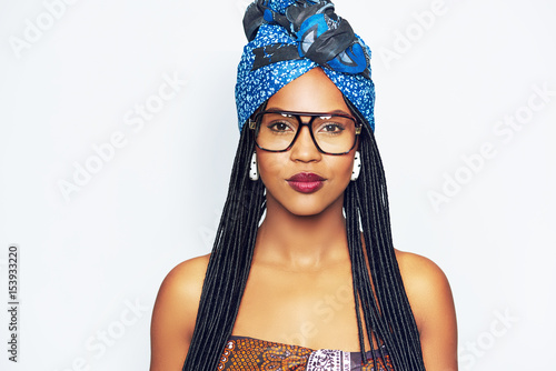 Young black woman in trendy blue headscarf