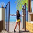 cartoon woman opens the gate on a tropical beach - 153950637