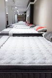 Closeup of many mattresses on display in store - 153992629