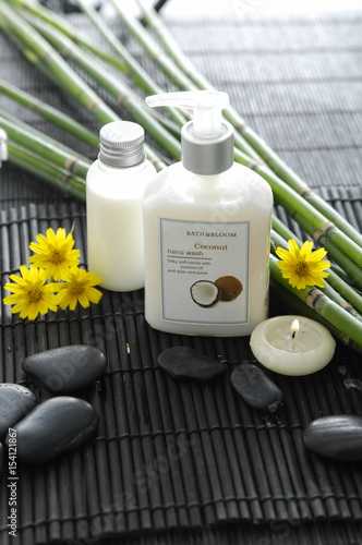 Poster Spa Spa setting with candle ,oil,yellow flower ,stones ,grove on mat