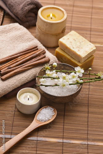 Tuinposter Spa Composition of bath tropical spa treatment on mat