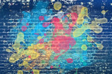 Paint splash on brick wall - 154150412