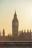 Big Ben and Golden Jubilee Bridges at sunset in London