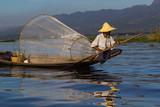 Traditional burmese fisherman on his boat at Inle lake