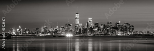 Fototapeta Panoramic view of Lower Manhattan Financial District skyscrapers in Black & White at dawn from New York City Harbor