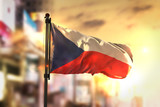Czech Republic Flag Against City Blurred Background At Sunrise Backlight