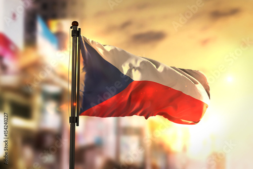 Poster Czech Republic Flag Against City Blurred Background At Sunrise Backlight