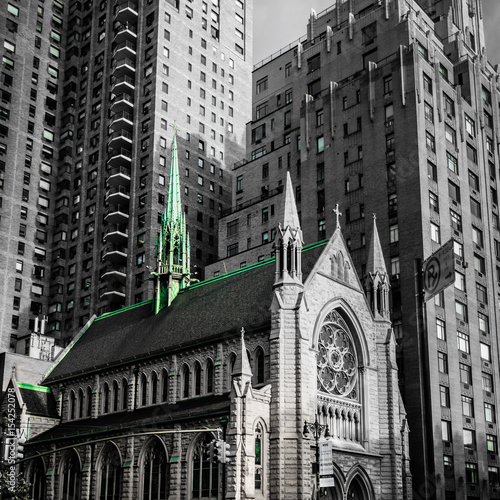 Fototapeta  Church in New York Manhattan caught by the modern skyscrapers black white green