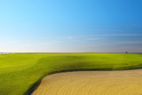 Green golf field on the sunny coast of Mediterranean sea