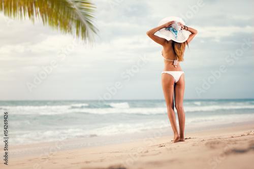 woman in sexy bikini looking in sea