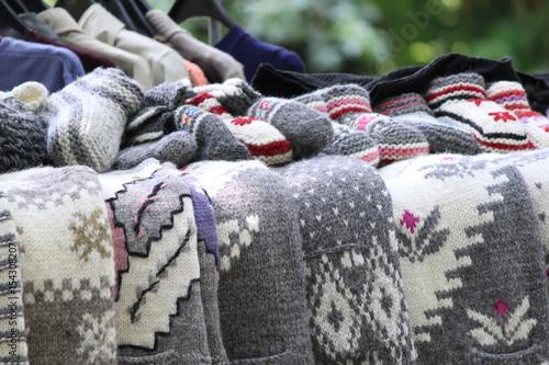 Plagát Handmade woolen knitted jumpers and socks