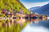 Classic postcard view of famous Hallstatt lakeside town reflecting in Hallstattersee lake in the Austrian Alps in scenic morning light on a beautiful sunny day in summer, Salzkammergut region, Austria - 154346424