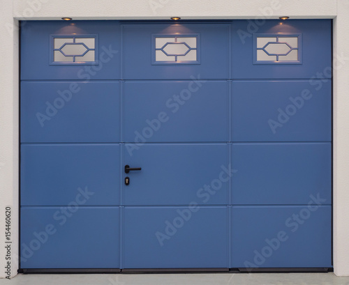 the facade of the garage with metal gates blue color