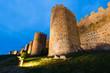 Medieval walls of Avila illuminated at evening,Spain