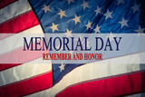 Fototapety Text Memorial Day and Honor on flowing American flag background. Concept of Memorial day or Veteran's day in America.