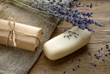 Lavender soap with dried lavender flowers on a wooden background