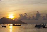 Beautiful sunrise seascape view with boat in phuket island.