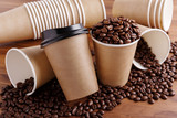 Paper coffee cups with beans