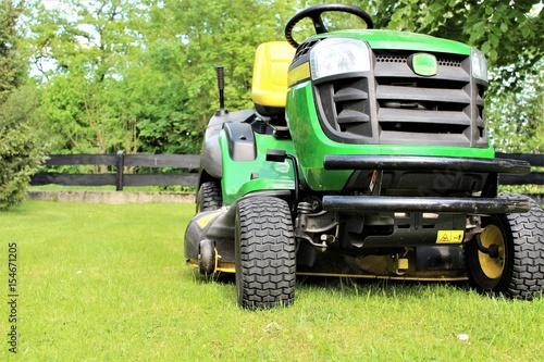 Fotobehang Trekker An image of lawn mowing