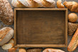Bread bakery background. Brown and white wheat grain loaves comp - 154685243