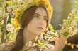 sensual girl portrait in spring flowers, toned image