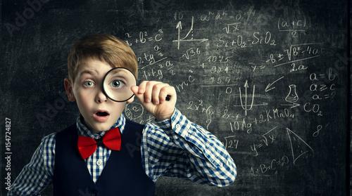 Fototapeta Child Magnifying Glass, Amazed School Kid, Student Boy with Magnifier Study Mathematics, Math Education