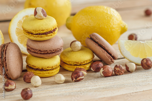 Yellow and brown french macarons with lemon and hazelnuts Poster