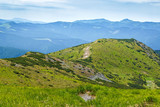 Carpathian mountains landscape. Green slopes along mountain ridge.