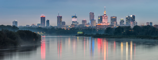 Night panorama of Warsaw skyline, Poland, over Vistula river in the night © tomeyk