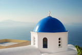 Iconic blue domed church in Santorini Greece