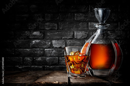 Whiskey and brick wall