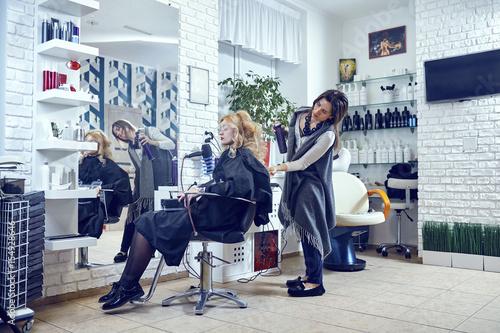 Hair styling in a beauty salon .