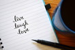 LIVE LAUGH LOVE inspirational quotation written in notebook