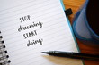 STOP DREAMING START DOING hand lettered motivational quote in notebook