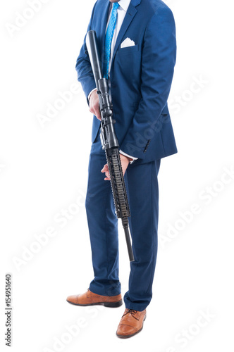 Unknown secret agent holding a dagerous weapon