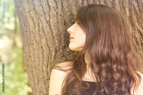 Woman portrait in side view posing outdoor