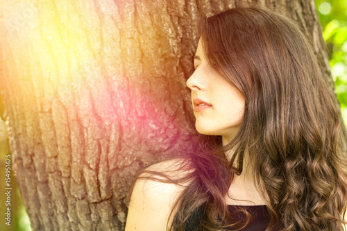 Beautiful young woman in the park in summer