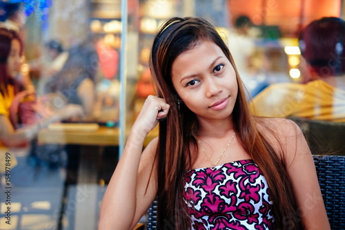 Young beautiful woman chilling outside the coffee-shop Poster