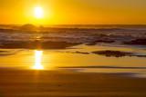 A placid early morning sunrise at Baggies Beach near Durban, South Africa.