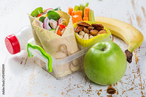 Lunch to go with tortilla wraps and vegetables