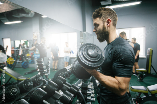 Man doing workout or training in the gym