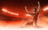 soccer player on soccer stadium celebrating a goal on red smoke background - 155019643