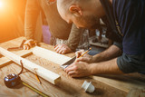professional carpenter working in the workshop - 155039677