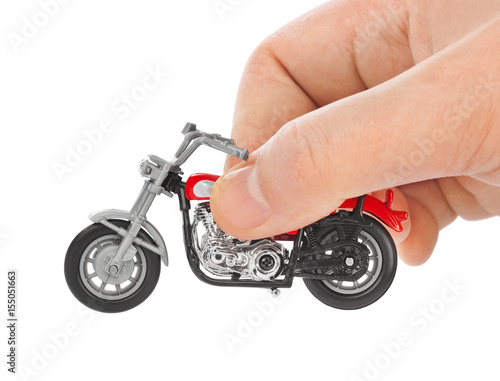Hand with toy motorbike