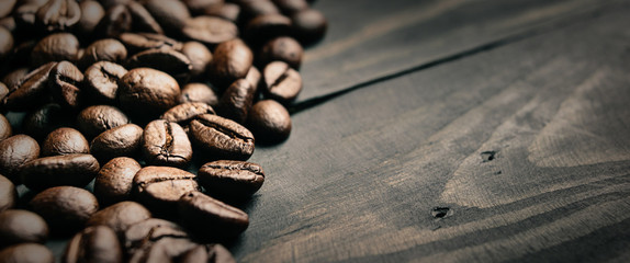 close up coffee bean on black wood © TKBstudio