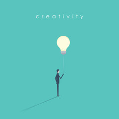 Business creativity vector symbol with businessman holding lightbulb on a string like a balloon. © jozefmicic