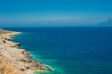 Sea coast, turquoise water and rocky hill. Road to Balos bay, Crete, Greece