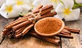 cinnamon powder on wooden background - 155064629