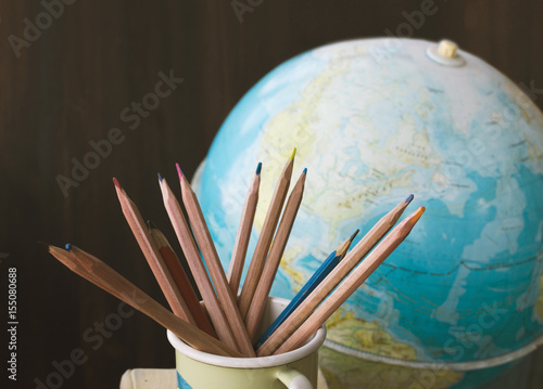 Plakat Pencils and vintage globe, back to school background, education, geography, sele