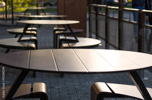 Empty tables of a street cafe at sunset on a summer evening Poster